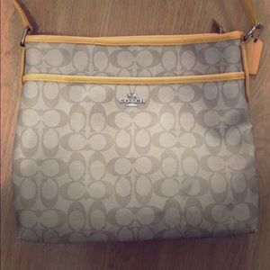 Yellow and tan coach purse